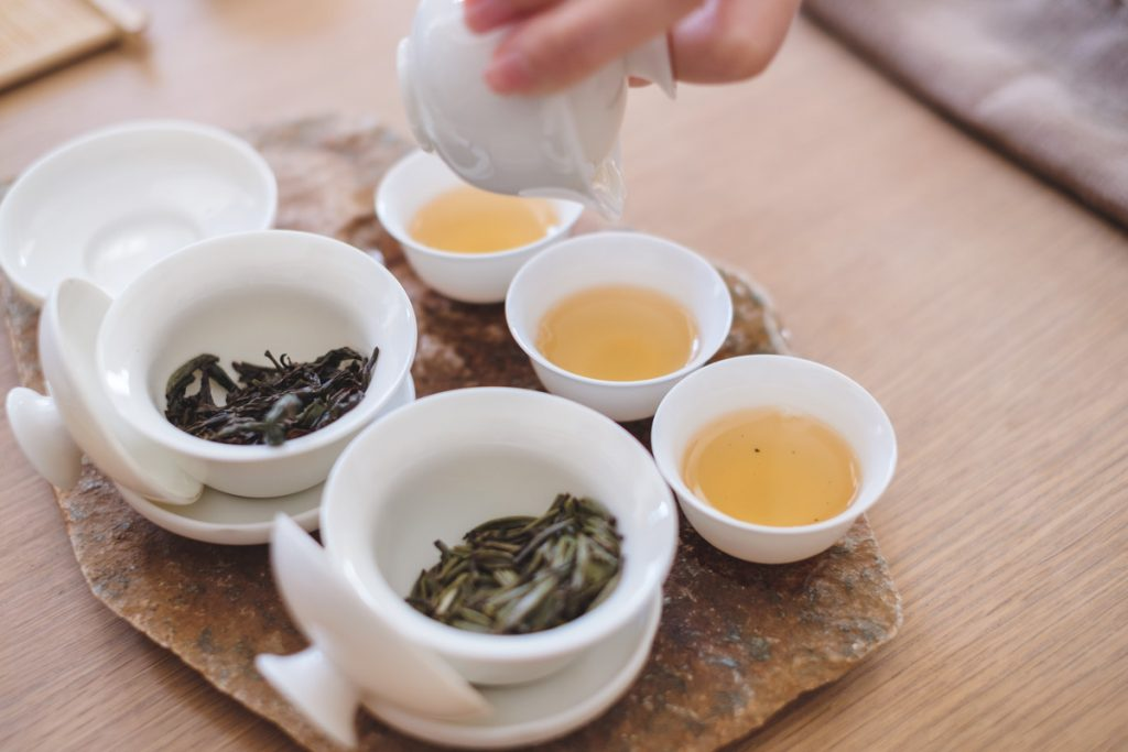 tea cups and gaiwan with Chinese oolong tea