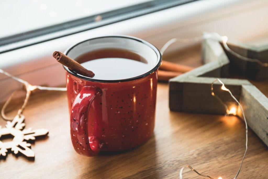 a cup of cinnamon spiced tea on the table