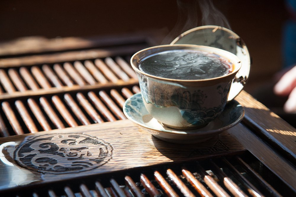 A cup of tea on a wooden table