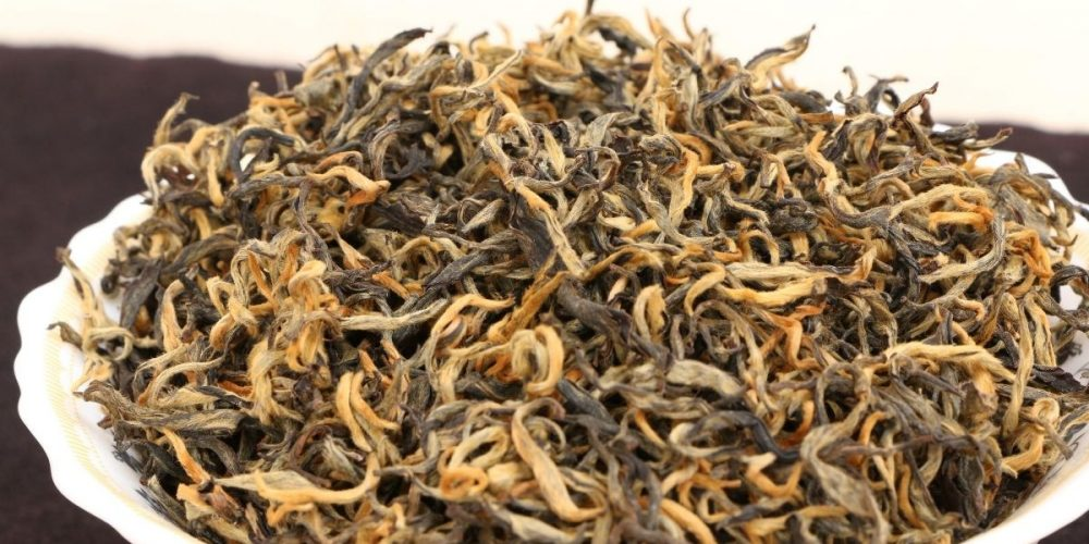 A bowl of loose Golden Monkey tea