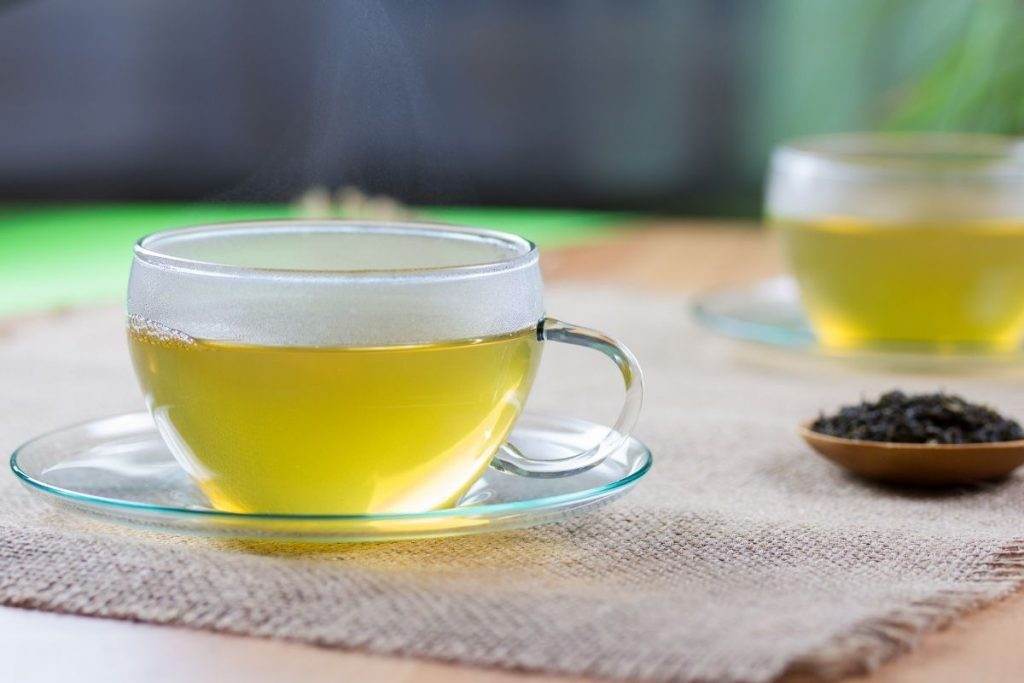 light-colored tea in a glass teacup