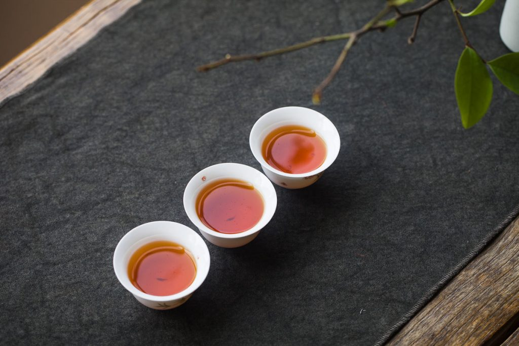 three teacups in traditional Chinese setting