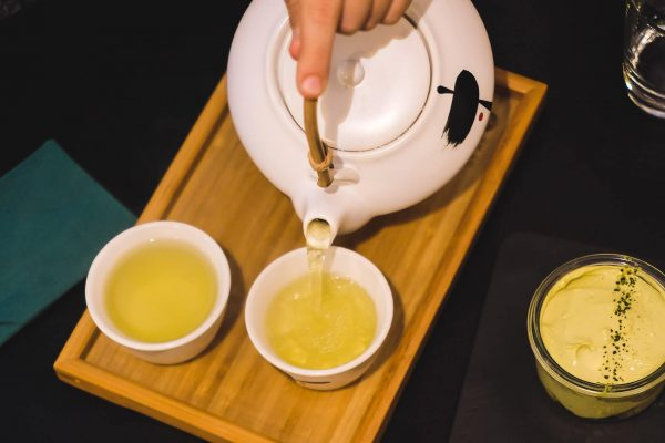 Pouring tea into small tea cups