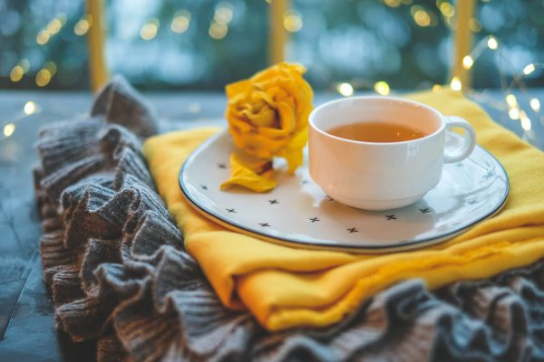 Cup of tea on yellow and grey rugs