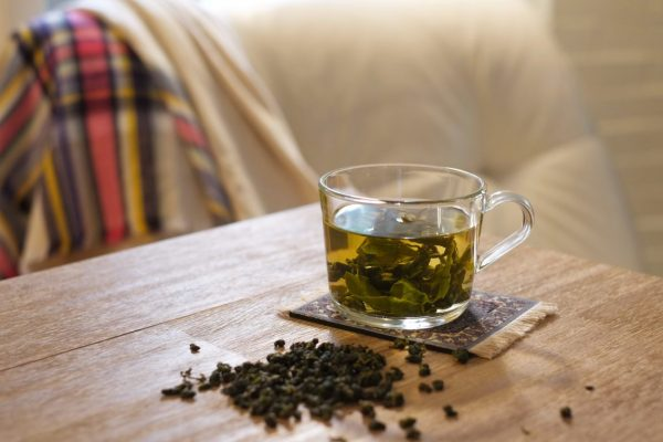 a cup of Milk Oolong tea and loose tea leaves