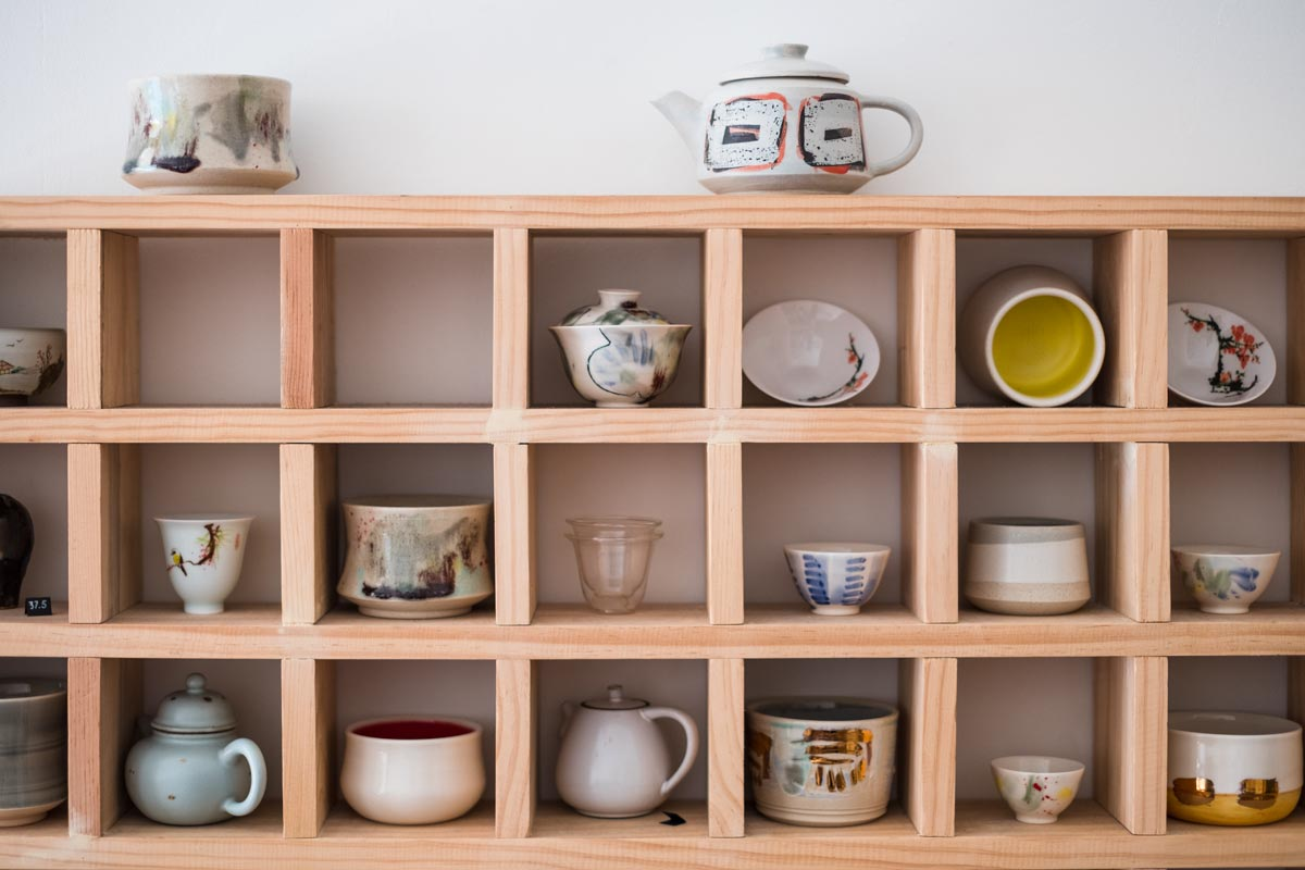 store display shelf with artisan teaware