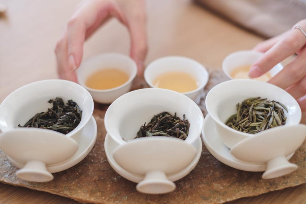 three gaiwans filled with wet tea leaves