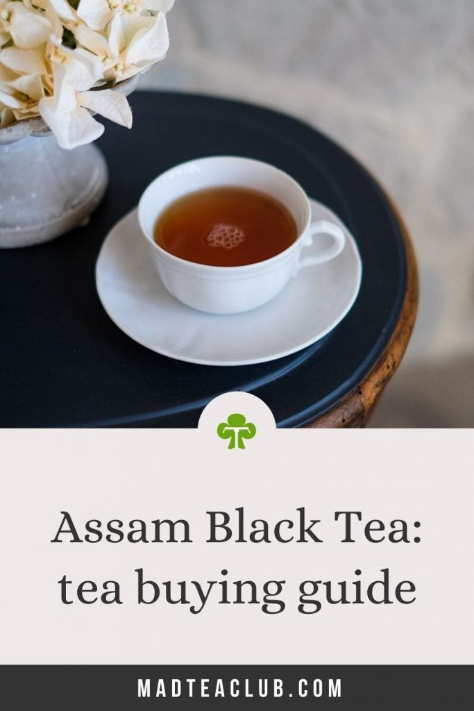"""Cup of tea on a table. Caption: """"Assam Black Tea: Tea Buying guide"""""""