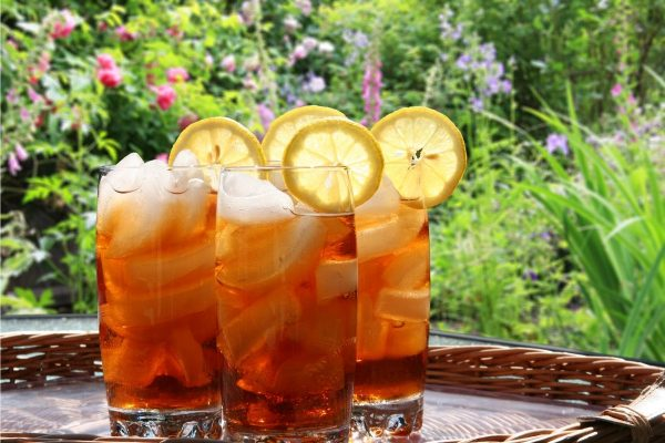 Tall glasses of homemade iced tea in the garden