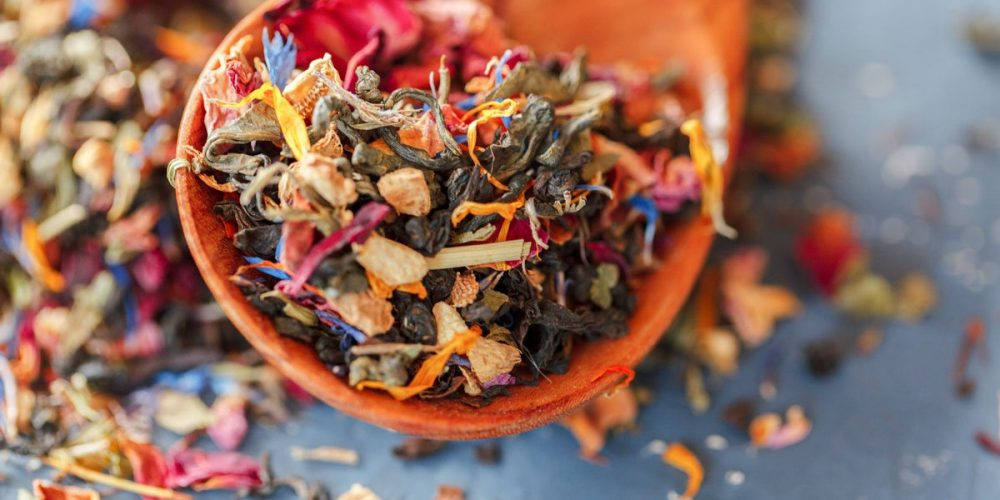 colorful loose leaf tea in a measuring spoon
