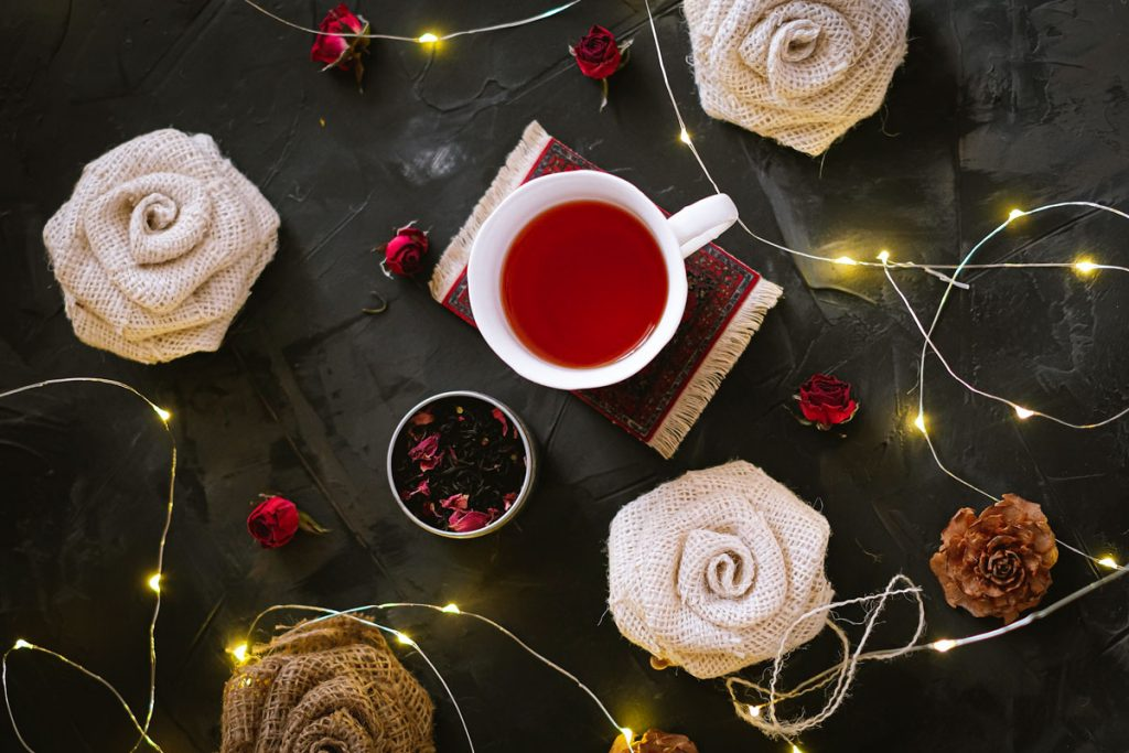 cup of tea, burlap roses, string of lights on a table